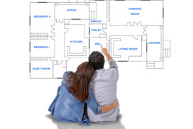 33471984 - young attractive couple in love happy together planning and pointing  blueprints , floor plan and design of new house, home, flat or apartment in real state concept